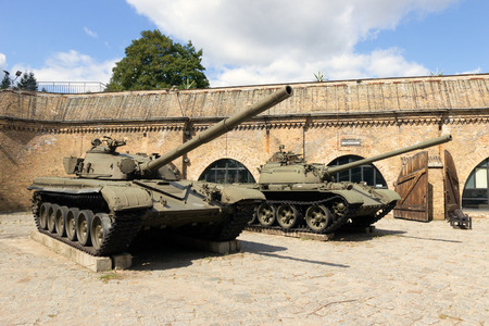 citadel: POZNAN, POLAND - AUG 20, 2014: Preserved T-72 and T-55 tanks on display in front of the Poznan Army Museum. The museum is recently re-opened after a long renovation.