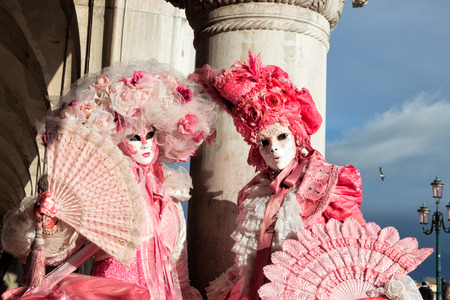 san marco: VENICE - FEB 6, 2013: Costumed people on the Piazza San Marco during the Venice Carnival. Editorial