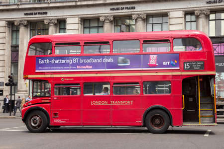 buses: LONDON - JUL 02, 2015: Red double-decker bus in a street of London, UK. Editorial