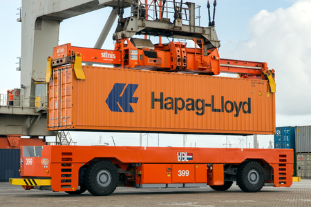 facilitate: ROTTERDAM - SEP 6, 2015: Crane operator picking up a sea container in the Port of Rotterdam. The port is the Europs largest and facilitate the needs of a hinterland with 40,000,000 consumers.