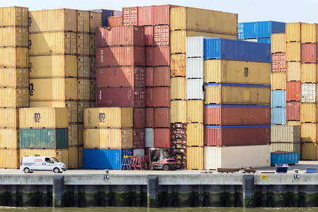 hinterland: ROTTERDAM, NETHERLANDS - AUG 1, 2014: Sea container terminal in the Port of Rotterdam. The port is the largest in Europe and facilitate the needs of a hinterland with 40,000,000 consumers.