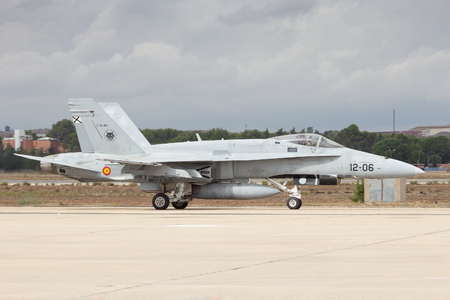 f 18: TORREJON, SPAIN - OCT 11, 2014: Spanish Air Force F-18 Hornet fighter jet taxiing beforer take-off from Torrejon airbase. Editorial