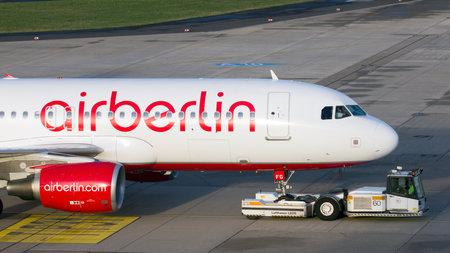 aerodrome: DUSSELDORF, GERMANY - DEC 17, 2015: Air Berlin Airbus A320 twoed towards the taxiway at Dusseldorf Airport.