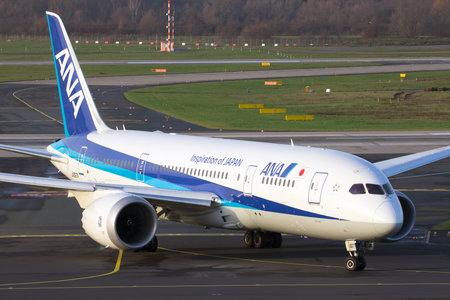 airways: DUSSELDORF, GERMANY - DEC 17, 2015: All Nippon Airways (ANA) Boeing 787 Dreamliner taxiing on Dusseldorf airport after landing. Editorial