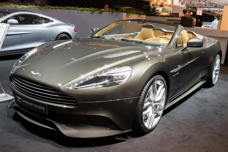 vanquish: AMSTERDAM - APRIL 16, 2015: Aston Martin Vanquish Volante sports car at the AutoRAI 2015. Aston Martin Lagonda Limited is a British manufacturer of luxury sports cars, founded in 1913.