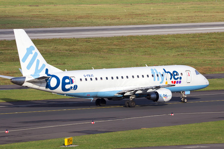 takeoff: DUSSELDORF, GERMANY - DEC 21, 2015: Flybe airline Embraer EMB-175 take-off for take-off at from Dusseldorf Airport.