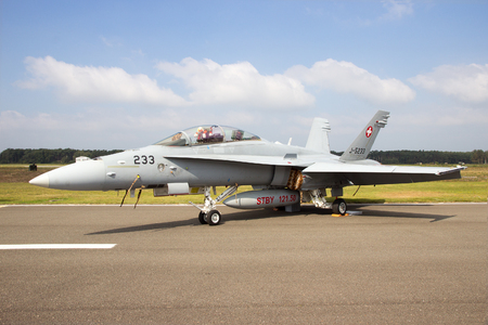 f 18: KLEINE BROGEL, BELGIUM - SEP 13, 2014: Swiss Air Force FA-18 Hornet on the taxiway of Kleine Brogel airbase. Editorial