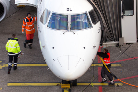 ei: DUSSELDORF, GERMANY - DEC 21, 2015: Alitalia Cityliner Embraer ERJ-175STD at the gate after landing at Dusseldorf Airport