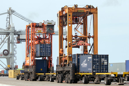 carriers: ROTTERDAM, NETHERLANDS - SEPTEMBER 8, 2013: Straddle carriers moving shipping containers in the Port of Rotterdam.
