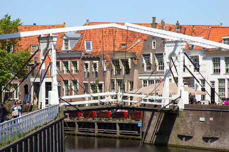 enkhuizen: ENKHUIZEN, THE NETHERLANDS - MAY 15: Draw bridge over a canal in the historic center of enkhuizen on May 15, 2014 in Enkhuizen, The Netherlands. The city was once one of the harbour-towns of the VOC.