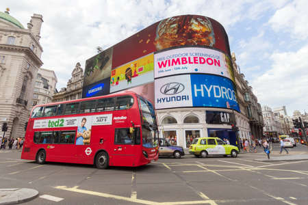 double decker: LONDON - JUL 1, 2015: Urban view with double decker bus at Piccadilly Circus. Editorial