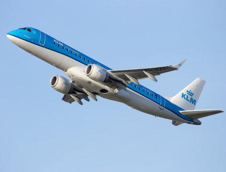 klm: AMSTERDAM-SCHIPHOL - FEB 16, 2016: KLM Cityhopper Embraer ERJ-190STD take-off from Schiphol airport Editorial