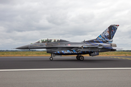 nato: SCHLESWIG-JAGEL, GERMANY - JUN 23, 2014: Special tiger painted Turkish Air Force F-16 fighter jet from 192Filo during the NATO Tiger Meet at Schleswig-Jagel airbase.