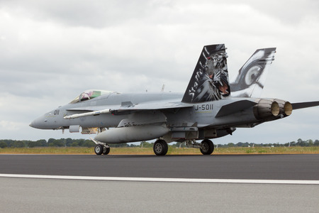 f18: SCHLESWIG, GERMANY - JUNE 23: Swiss Air Force FA-18C Hornet at the NATO Tigermeet on June 23rd, 2014 in Schleswig, Germany.