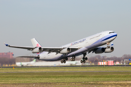 takeoff: AMSTERDAM-SCHIPHOL - FEB 16, 2016: China Airlines Airbus A340-313 take-off from Schiphol airport