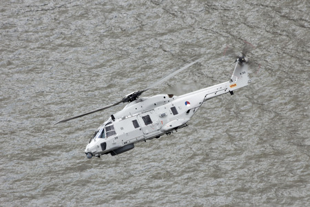 meuse: ROTTERDAM, THE NETHERLANDS - SEP 5, 2015: Royal Netherlands Navy NH90 helicopter flying over the Meuse river. Editorial