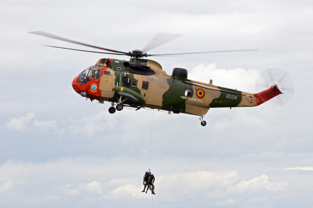 coastguard: GILZE RIJEN, THE NETHERLANDS - JUNE 21, 2014: Belgium Air Force Sea King rescue helicopter demonstration during the Netherlands Air Force Open Day.