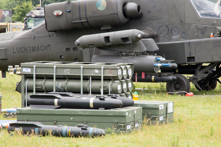 apache: GILZE-RIJEN, NETHERLANDS - JUNE 20: Rockets and weaponry for the Apache attack helicopter on display at the Royal Netherlands Air Force Days