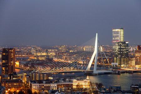 rotterdam: ROTTERDAM, NETHERLANDS - MAR 16, 2016: Evening view on the Erasmus bridge in Rotterdam