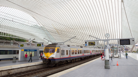 liege: LIEGE, BELGIUM - AUG 5, 2014: The Liege-Guillemins railway station. This station is made of steel, glass and white concrete designed by Spanish architect Santiago Calatrava.