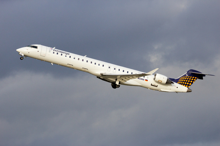 takeoff: DUSSELDORF, GERMANY - DEC 21, 2015: Eurowings Canadair CRJ-900LR take-off from Dusseldorf Airport. Editorial