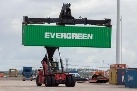 dockside: ROTTERDAM, NETHERLANDS - SEP 6, 2015: Mobile container handler in action at a container terminal in the Port of Rotterdam