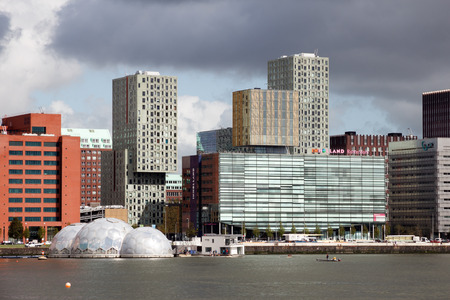 rotterdam: ROTTERDAM - SEP 5, 2015: View on Rotterdams Kop van Zuid neighorhood with its solar-powered floating pavilion and Inholland University, among other buildings.