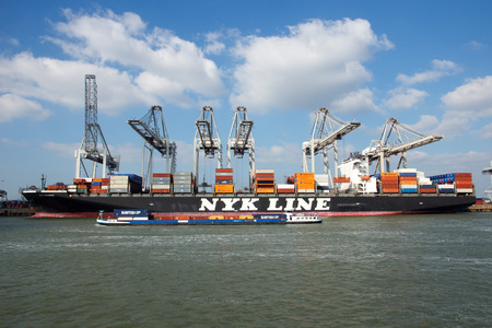 rotterdam: ROTTERDAM, NETHERLANDS - MAR 16, 2016: Container ship Nyk Oceanus from NYK Line moored at a container terminal in the Port of Rotterdam. Editorial
