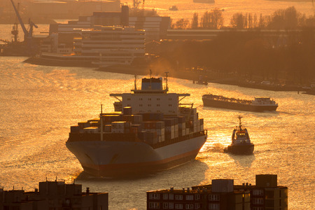 Ship on the Meuse river in the Port of Rotterdam during sunset Stock Photo