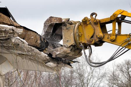 demolishing: Demolition crane dismantling a building