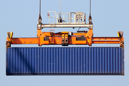lifted: Sea container lifted by a harbor crane