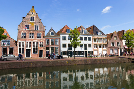 hoorn: HOORN, NETHERLANDS - MAY 15: Row of canal houses along a canal in Hoorn. The City is founded in 716 and was an important VOC home base.