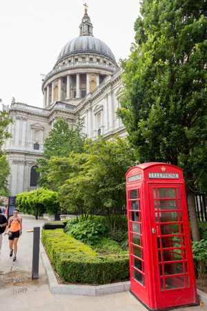 st pauls: LONDON - JUL 1, 2015: Traditional red telephone box in front of St Pauls Cathedral.