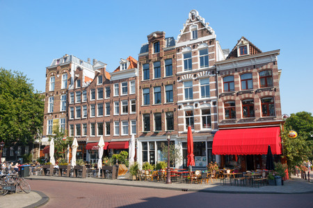 canal houses: AMSTERDAM - AUG 27, 2014: Restaurants in typical canal houses on the Kadijksplein in Amsterdam Editorial