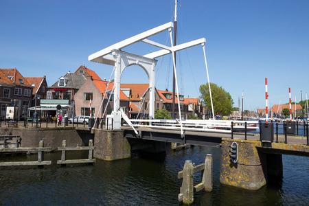 draw bridge: ENKHUIZEN, THE NETHERLANDS - MAY 15: Draw bridge over a canal in the historic center of enkhuizen on May 15, 2014 in Enkhuizen, The Netherlands. The city was once one of the harbour-towns of the VOC.