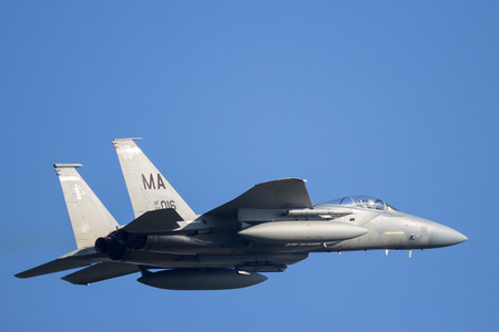 LEEUWARDEN, NETHERLANDS - APR 11, 2016: Massachusetts Air National Guard F-15C Eagle take off from Leeuwarden airbase to participate in exercise Frisian FLag. The ANG is in Europe for a 6-month deployment in support of Operation Atlantic Resolve.