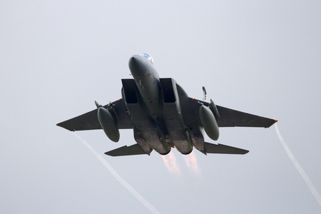 leeuwarden: LEEUWARDEN, NETHERLANDS - APR 8, 2016: Massachusetts Air National Guard F-15C Eagle take off from Leeuwarden airbase. The ANG is in Europe for a 6-month deployment in support of Operation Atlantic Resolve.