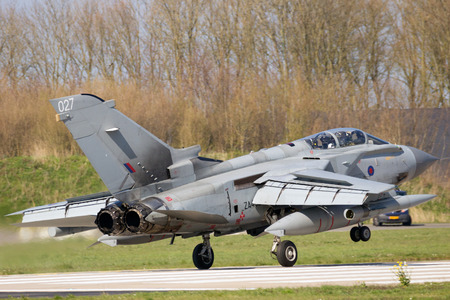 aircraft bomber: LEEUWARDEN, THE NETHERLANDS - APR 11, 2016: Royal Air Force Tornado GR4 fighter jet landing during the exercise Frisian Flag. The exercise is considered one of the most important NATO training events this year.