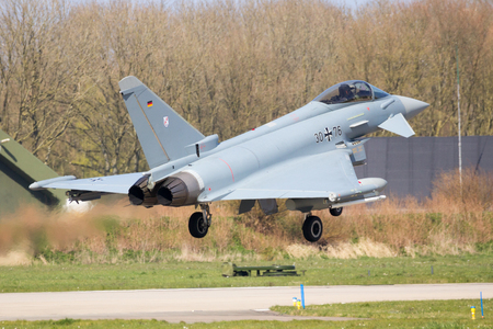 leeuwarden: LEEUWARDEN, THE NETHERLANDS - APR 11, 2016: German Air Force EF2000 Eurofighter from JaboG 31 Boelcke landing during the exercise Frisian Flag. The exercise is considered one of the most important NATO training events this year.