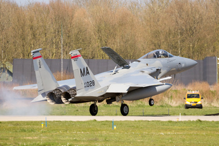 LEEUWARDEN, NETHERLANDS - APR 11, 2016: Massachusetts Air National Guard F-15C Eagle landing at Leeuwarden airbase to participate in exercise Frisian FLag. The ANG is in Europe for a 6-month deployment in support of Operation Atlantic Resolve.