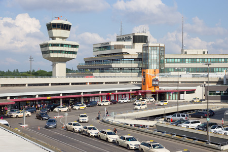 industry architecture: BERLIN - JUN 1, 2016: Taxis in front of the airport terminal of Berlin-Tegel airport. This airport is the main international airport of Berlin.