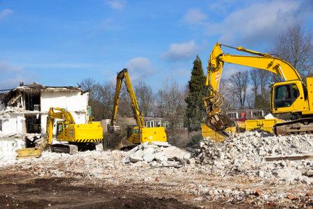 dismantle: Demolition cranes dismantling a building