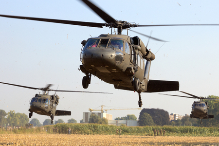 blackhawk helicopter: GRAVE, NETHERLANDS - SEP 17: American Black Hawk helicopters take off at the Operation Market Garden memorial on Sep 17, 2014 Grave, Netherlands. Market Garden was a large Allied operation in 1944.