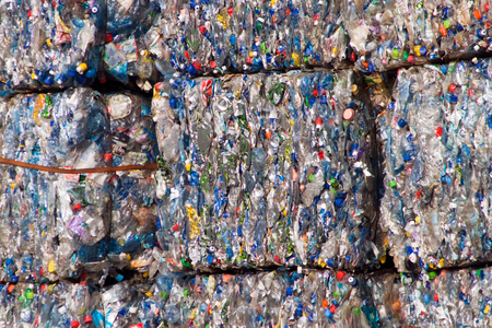 recycling plant: Compacted recyclable plastic waste at a recycling plant.