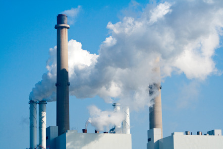 smoke stack: Smoke from factory pipes Stock Photo