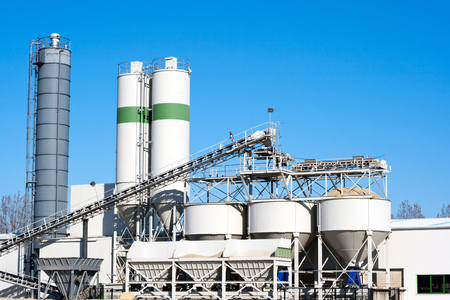 Cement factory machinery on a clear blue day Standard-Bild