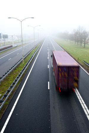 freight forwarding: Truck on a highway in misty weather