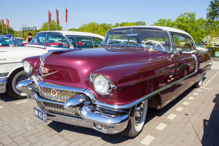 ROSMALEN, THE NETHERLANDS - 1956 Cadillac Coupe De Ville on the parking lot of the ROck Around The Jukebox Event.