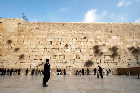 kabbalah: JERUSALEM, ISRAEL - JANUARY 23: Jewish worshipers pray at the Wailing Wall. The most holy site for Jews. January 23, 2011 in Jerusalem, Israel. Editorial