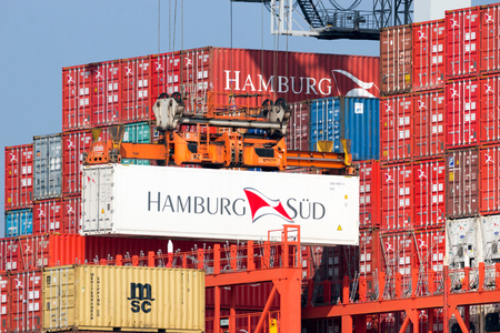 sud: ROTTERDAM, NETHERLANDS - MAR 16, 2016: Container from Hamburg Sud is loaded onto a ship in the Port of Rotterdam. Editorial